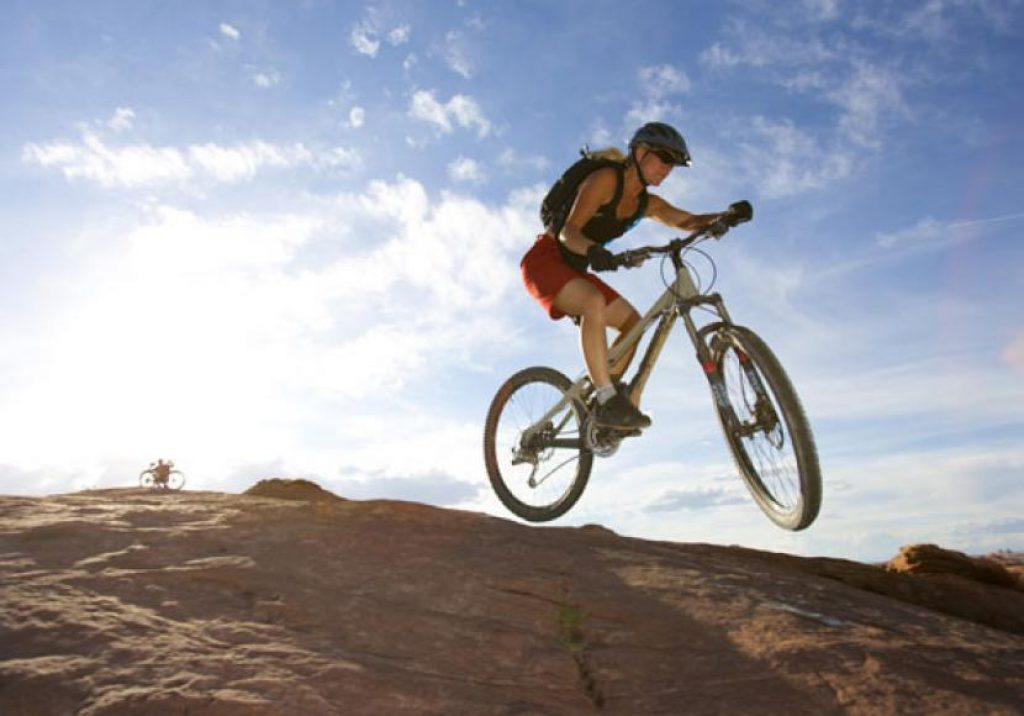 Women mountain bike riding